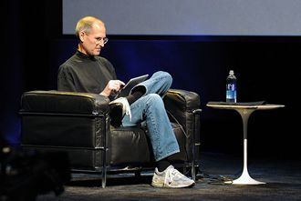 The late Steve Jobs with an iPad