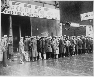 1200px-Unemployed_men_queued_outside_a_depression_soup_kitchen_opened_in_Chicago_by_Al_Capone,_02-1931_-_NARA_-_541927